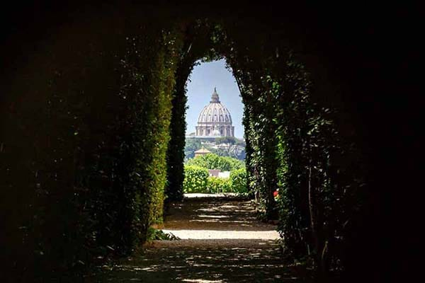 The Vatican through a tunnel of greenery.