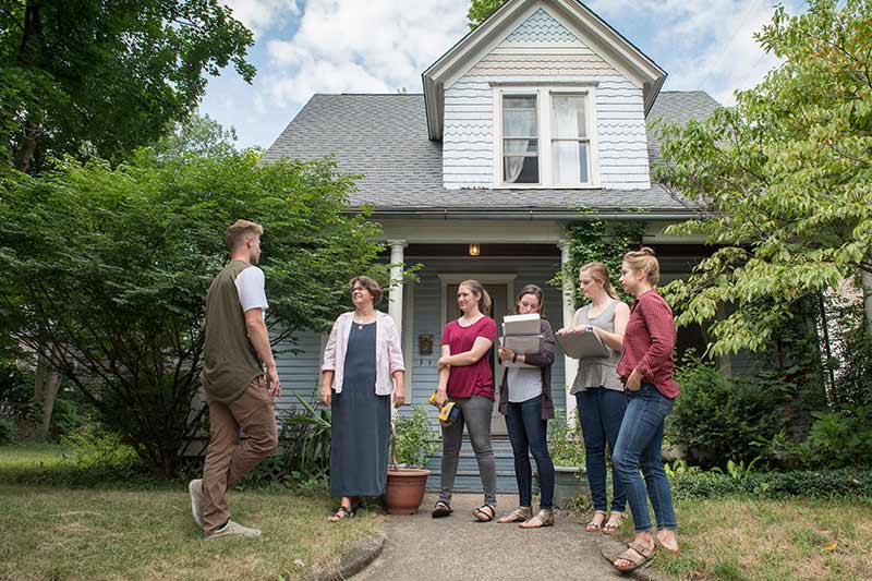 A group of researchers stand in front of a house in South Bend